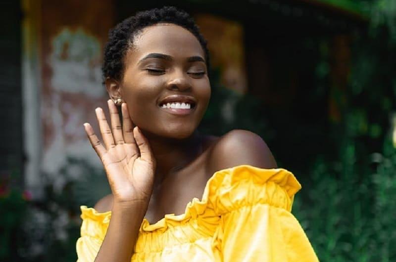 beautiful smiling woman in yellow dress
